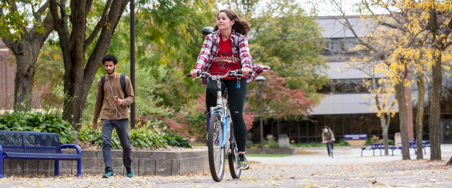 Student Biking on the MSU Mall in the fall