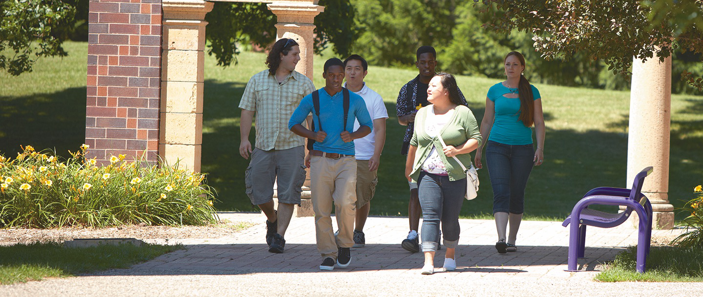 Students walking by Arch